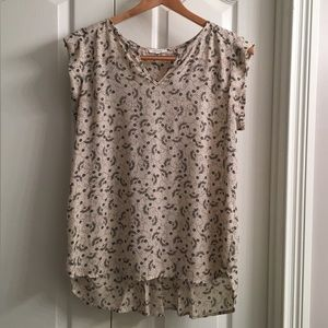Pleione Flowy Sleeveless Blouse with Pleated Back